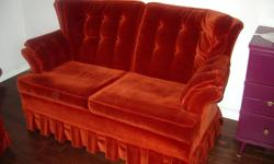 One loveseat upholstered in high quality velvet finish russet coloured material. Very clean and easy to maintain. Ideal for living room, bedroom or den.