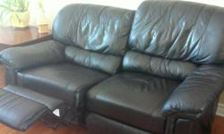 ELRAN. Black loveseat with recliner, good condition. Great offer!!!