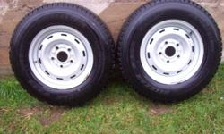 LT 225 75R16--BRIDGESTONE BLIZZAK  2 tires on rims used two seasons.  Lots of tread still left.  Some rust as pictures will show.  $250.  Firm.