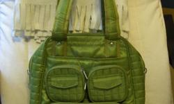 """I have a lug bag for sale in grass green colour. It is in great condition as I used it only couple of times. It can be used as a gym bag or a diaper bag. Dimensions: 11""""w x 13.5""""h x 6""""d. Paid over $62+ tax. (there is a tiny tear on the bottom of the"""