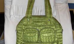 """I have a lug bag for sale in grass green colour. It is in great condition as I used it only couple of times. It can be used as a gym bag or a diaper bag. Dimensions: 11""""w x 13.5""""h x 6""""d. Paid over $62+ tax. Asking $28 firm. (there is a tiny tear on the"""