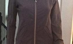 Beautiful dark grey Lululemon jacket in size 6. Has thumb holes, in perfect condition.