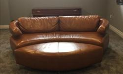 Luxurious Couture Designer curved sofa and footrest. Top quality leather with impeccable craftsmanship. Moving .Priced to sell. Paid 4800$ just reduced further from 1350$ to 1250$