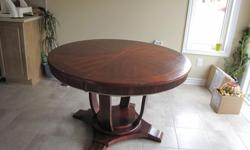 A luxurious table with 4 chairs in great condition for sale.Extension included Best offer