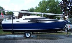 2004 Macgregor 26 m sailboat for sale Blue hull Water ballest Honda 50 hp motor trailer included Covered enclosure Main sail with Genoa on roller furler Starter battery and 3 deep cell bateries Battery changer 1000 w inverter bar fridge ,sink with maunal