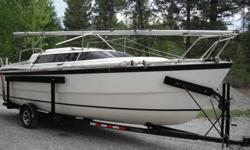 2000 26X fresh water use only.  70 hp Evinrude EFI four stroke.  Nice boat in great shape with many extras: CDI roller furling, jenniker sail, sail covers, depth/fish finder, cockpit table, SS BBQ, cockpit biminy, two batteries, anchor and chain with