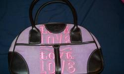 """Asking $20 or best offer!! Lavender in colour with pink writing and black accent 2 Handles, no pocket making lots of room on the inside Removable solid bottom for inside of purse Zipper is working, Key chain states """"VS"""" In Perfect Condition, great for any"""