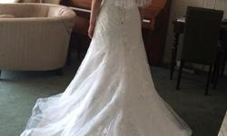 Beautiful unaltered Maggie Sottero dress. Bought from Blush boutique, worn once. Size 6 with extra boning on the tummy for a very slimming effect ? Professionally drycleaned and ready to go! Dress hasn't been hemmed and is the perfect length with 2 inch