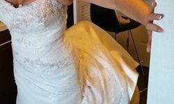 This gown was taken in to about a 10. I am 5'4 and about 125lbs. Everyone mentioned how beautiful the gown was! It has little crystals on it that glitter in the sun and almost change colours. Please come and try it on! I have a veil I would throw in with