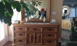 Beautiful Maple Dresser and matching mirror. Dresser 72 x 20 x 36, Mirror measures 48 x 41. Like new.