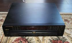 Works great. No remote. Plays CD's, CD-R's & CD-RW's. 5 disc changer. Made in 1999. Rarely used. No issues.