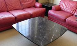 Solid Italian Marble coffee table and end table, black and grey/white marbling. Separate top and bottom peices for each. End table has on one corner peice with marble chunk missing (still have peice, easily concealed), still great tables!