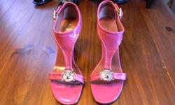 Glamorous Patent Cerise Gladiator. These attractive shoes are size 9 womens (true to size) in a medium width. These shoes look as new and have only been worn once. They are in excellent condition inside and out, feature a 3 1/2 inch heel are unmarked in