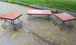 Matching coffee table and end tables, wrought iron feet, wood surfaces, cherry colour. Asking $100 for the set