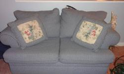 Matching Couch and Loveseat in Denim Fabric with 4 matching reversible cushions! If interested please call 403-755-0977, leave message if no answer.