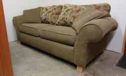 Comfortable , reversible couch and loveseat. From a non smoking home. Pictures of the loveseat are lighter because of the flash, both the couch and the loveseat are the same colour. Located in Chemainus