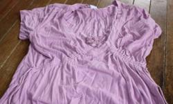 Pink short sleeved Tshirt from transition.  Size small.  Tightens around the breast area