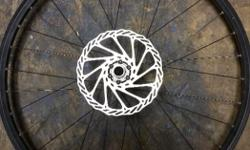 """26"""" Mavic front rim with Shimano rotor, good condition, only minor scuffs in the paint, nice & straight, through axel."""