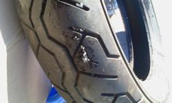 Gently used rear tire. Didn't leak while mounted so should be fine. Cleaning out garage. Please be sure of your rear tire size before responding as I would rather not look it up for you ;)