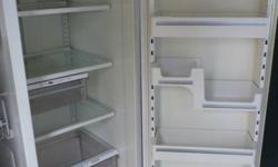 "White ""Maytag Plus"" side-by-side refridgerator, in great condition, everything works perfect. It has an ice maker and water dispenser on the door. Selling because our dishwasher broke and we decided to buy all new stainless appliances. Size is 67 3/4"""