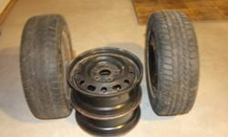 FOUR USED RIMS WITH TWO SNOW TIRES 195/15/R60 IN GOOD CONDITION.