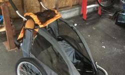Orange Bike Trailer and Stoller single Like new and hardly used