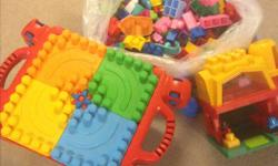 Daycare closing. Mega Bloks table that folds flat for storage. Farm house and a large bag of /blocks/cars/asst shaped blocks $30