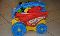 Mega Bloks and dump wagon. Brimming with bloks. Very good condition.