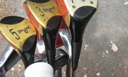 Complete set of LH 1, 3 & 5 woods. 5,6,7,8,9 irons. Pitching wedge, sand wedge and putter - all in good condition. MacGregor Cart Included.