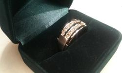 Men's white gold diamond wedding ring. Polished white gold with raised brushed white gold sides. .33ct diamond weight 10k white gold.   Purchased at Mappins Jewellers with lifetime warrenty. Warrently can be transfered to buyers name. I believe the ring