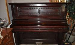 Very Fine Antique Upright Piano Mendelssohn by Gourlay, Winter, and Leeming 188 Yonge Street Toronto Very Ornately Decorated Beautiful Carvings and Pin striping Serial #7168 Needs to be Tuned With Original Stool Claw and Glass Ball Feet on Stool