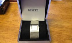 Selling my mens DKNY watch, complete with box and maual. Never worn. paid $155 for it, will settle for $70