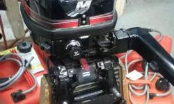 9.9 hp 2 stroke 2011 model runs good with tank and hose