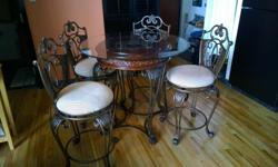 """I'm selling due to a new perches my antique looking metal table and matching chairs. It has seen very little use of the last couple years and is quite beautiful too. its hard to descried so look at the pictures. the table is 40"""" diameter and 3' tall so"""