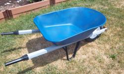 """Metal wheelbarrow for sale. Square tubing metal handles. 24"""" wide. Only $60. We are located in Orleans. See our list of other ads for sale. First come, first served."""