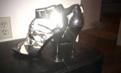 Michael Kors size 7, snake skin and leather, never worn. Contact with offer.