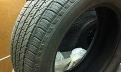 SET OF FOUR ALL SEASON TIRES USED ONE SUMMER, LESS THAN 10,000 KM ON THEM