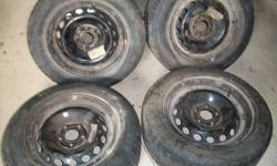 """Full set of Michelin X Ice winter tires very good condition .180 """" depth left. Comes on steel rims fits Ford Taurus or Volvo. $300.00 O.B.O. Call 905-880-3082."""