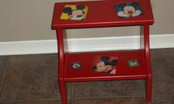 Look brand new! Mickey Mouse 2 step solid wood red stool with nonskid mickey mouse appliques. Great for bathroom/bedroom/kitchen anywhere it's needed. Asking $15.00