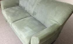 This couch is a steal! It's in great condition and is very comfortable. Was purchased at Sears about 5 years ago for $700. We had this in our living room but have since purchased a bigger couch. The colour is a neutral grey/green and fits 2 comfortably.