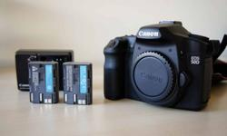 Here for sale is my absolutely MINT condition Canon EOS 50D. It's a bit over a year old with only 9000 actuations. I can show you by EOS Info program when you test it. Mint condition without any scratch or dent. It comes with strap, charger, and 2 genuine