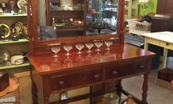 A beautiful piece of local history, this mahogany 2 drawer dresser with large bevelled mirror was made in the early 1900's by DC Timewell Co. on Granville St in Vancouver BC. Perfect in an entranceway, or as a sideboard or a vanity. 48? long, 22? deep,