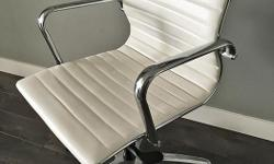 White Eames-style faux leather desk chair. Solid construction, fully adjustable and in great condition.
