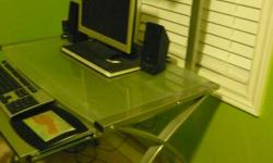 Modern Glass desk with retractable keyboard shelf and book shelf. Very sturdy and in excellent condition. Great for small spaces and students. $50 firm Pick up required in Rockwood (10 mins east of Guelph)