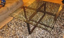 Modern square glass top coffee table in great condition.  No longer needed due to decor changes.  If you have any questions please email me.   Glass top 40'' x 40'' Height 19½''   Asking $125obo