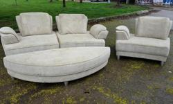 Modular sofa with matching chair for sale. Both have movable arm/back rests so you can change the look and set up to suit yourself. Sofa has matching oval ottoman, together big enough for two to sleep on. Needs a freshening up, but otherwise good. Asking
