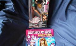 """This doll is new and has never been removed from the box. From the Frights Camera Action series. PLUS brand new 2014 book """"Monster High Activity Book, Stickers Included"""". Great gift for collectors! Still available for cash pickup if you see the ad."""