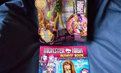 BRAND NEW in box. From the Freaky Fusion collection, Clawvenus doll. PLUS BONUS Monster High Activity Book. AWESOME GIFT for COLLECTORS!!! Accessories include a to-die-for purse, doll stand, brush and humorous fusion diary! Clawvenus is a blend of