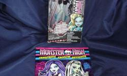 """This doll is new and has never been removed from the box. PLUS brand new 2014 book """"Monster High Monster Makeup Book, Stickers Included"""". Great for collectors! Lagoona Blue, daughter of the sea monster. From the 2013 Frights, Camera Action! Black Carpet"""