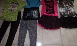 Everything in the pictures is for this price. All clothing is in very good shape. There is 3 pyjamas, 1 shirt, 2 skirts to dress up, 2 pant sets and 2 skirt sets that have shorts attached to the skirt.